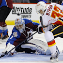 Colorado Avalanche goalie Semyon Varlamov makes a save against Calgary Flames center Paul Byron (32) during the second period of a preseason NHL hockey game Sunday, Sept. 28, 2014, in Denver. The Associated Press