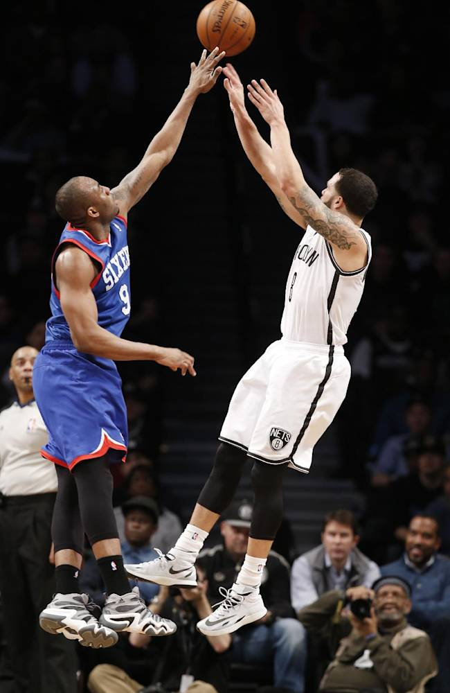 Brooklyn Nets point guard Deron Williams (8) shoots over the defense of Philadelphia 76ers guard James Anderson (9) in the second half of their NBA basketball game at the Barclays Center, Monday, Feb. 3, 2014 in New York. The Nets defeated the Sixers 108-102