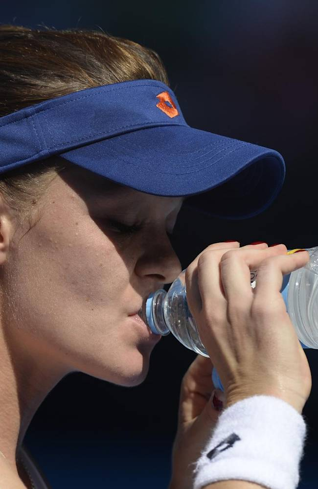 Agnieszka Radwanska of Poland  takes a drink during a break in the semifinal against Dominika Cibulkova of Slovakia at the Australian Open tennis championship in Melbourne, Australia, Thursday, Jan. 23, 2014