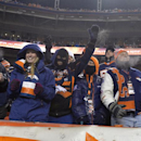 Football fans cheer after a Denver Broncos touchdown against the Tennessee Titans during an NFL football game on Sunday, Dec. 8, 2013, in Denver. (AP Photo/Jack Dempsey)