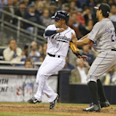 San Diego Padres' Alexi Amarista crosses home pate as Colorado Rockies pitcher Jorge De La Rosa awaits a throw after a pass ball by catcher Jordan Pacheco in the fifth inning of a baseball game Wednesday, April 16, 2014, in San Diego The Associated Press