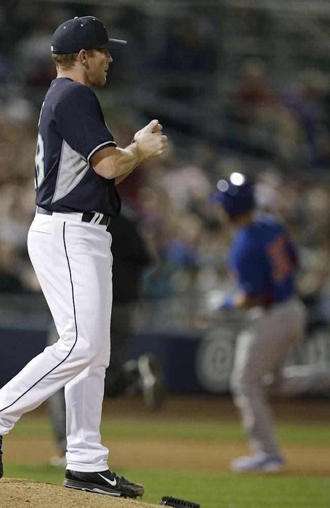 Seattle Mariners starting pitcher Randy Wolf gets a new baseball after Chicago Cubs' Mike Olt hit a solo home run during the second inning of a spring exhibition baseball game Wednesday, March 12, 2014, in Peoria, Ariz