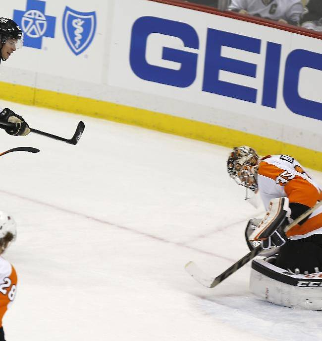 Pittsburgh Penguins center Sidney Crosby (87) misses a shot that goes past Philadelphia Flyers goalie Steve Mason (35) during the third period of an NHL hockey game on Sunday, March 16, 2014, in Pittsburgh. The Flyers won 4-3