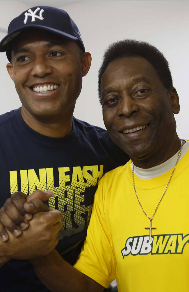 SUBWAY Global Ambassador Pele, right, the greatest footballer of all time, meets Mariano Rivera, the greatest closer of all time, for the first time ever at a SUBWAY Restaurant in Rio de Janeiro, Brazil, on Saturday, July 12, 2014. (Photo by Dado Galdieri/Invision for SUBWAY Restaurants/AP Images)