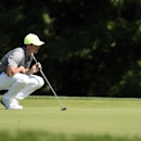 Jun 18, 2016; Oakmont, PA, USA; Rory McIlroy lines up a putt on the 15th green during the continuation of the second round of the U.S. Open golf tournament at Oakmont Country Club. Mandatory Credit: John David Mercer-USA TODAY Sports