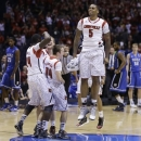 Louisville's Chane Behanan leaps in the air as he wears the jersey of injured teammate Kevin Ware as he and teammates celebrate their 85-63 win over Duke in the Midwest Regional final in the NCAA college basketball tournament, Sunday, March 31, 2013, in Indianapolis. (AP Photo/Darron Cummings)