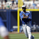 Kansas City Royals' Pedro Ciriaco throws out San Diego Padres' Xavier Nady during the fourth inning of a spring exhibition baseball game Sunday, March 16, 2014, in Peoria, Ariz The Associated Press