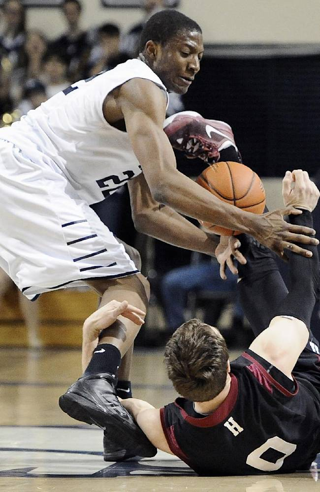 Yale's Justin Sears, left, tangles with Harvard's Laurent Rivard, right, during the first half of an NCAA college basketball game, Friday, March 7, 2014, in New Haven, Conn