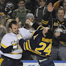 Nashville Predators' Paul Gaustad (28) and Buffalo Sabres' Zenon Konopka (24) fight during the second period of an NHL hockey game in Buffalo, N.Y., Tuesday, March 11, 2014 The Associated Press