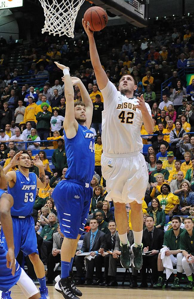 North Dakota State's Marshall Bjorklund goes up for a shot over Indiana-Purdue-Fort Wayne's Jordan Aaberg during the second half of an NCAA college basketball game for the Summit League men's tournament title, Tuesday, March 11, 2014, in Sioux Falls, S.D. North Dakota State won 60-57