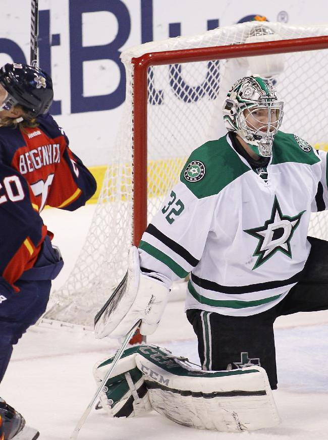 Florida Panthers left wing Sean Bergenheim (20) reacts after his game-winning goal as Dallas Stars goalie Kari Lehtonen (32) looks on during the third period of an NHL hockey game in Sunrise, Fla., Sunday, April 6, 2014