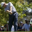 Ernie Els of South Africa hits his tee shot on the fourth hole during third round play in the 2013 Masters golf tournament at the Augusta National Golf Club in Augusta, Georgia, April 13, 2013. REUTERS/Mike Segar