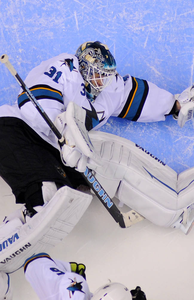 San Jose Sharks goalie Antti Niemi, of Finland, block a shot during the third period in Game 3 of an NHL hockey first-round playoff series against the Los Angeles Kings, Tuesday, April 22, 2014, in Los Angeles
