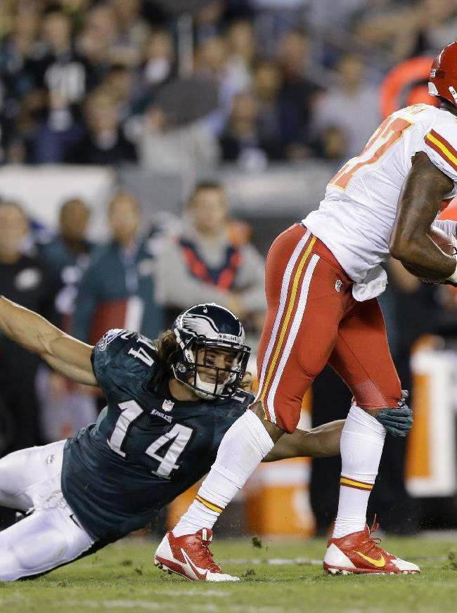 Kansas City Chiefs' Sean Smith, right, returns an interception as Philadelphia Eagles' Riley Cooper defends during the first half of an NFL football game, Thursday, Sept. 19, 2013, in Philadelphia