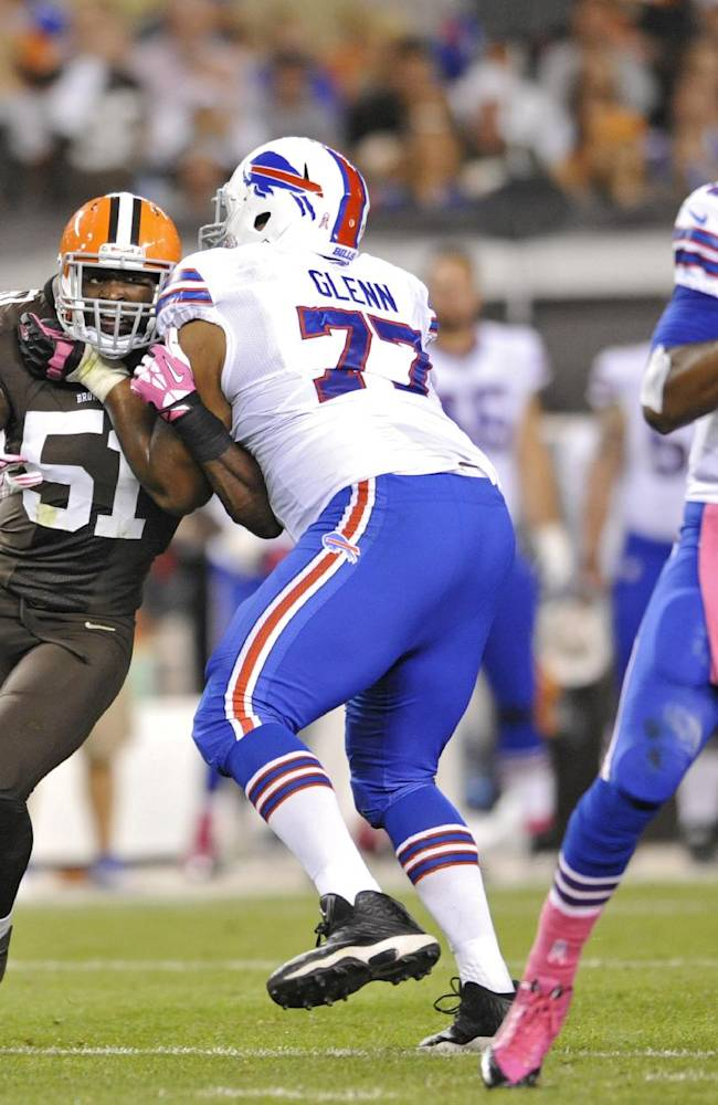 Cleveland Browns outside linebacker Barkevious Mingo (51) tries to get past Buffalo Bills tackle Cordy Glenn (77) to quarterback EJ Manuel in the second quarter of an NFL football game Thursday, Oct. 3, 2013, in Cleveland