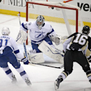 Pittsburgh Penguins' Brandon Sutter (16) lifts a shot over Tampa Bay Lightning goalie Ben Bishop (30) for a goal during the first period of an NHL hockey game against the Tampa Bay Lightning in Pittsburgh Monday, Dec. 15, 2014 The Associated Press