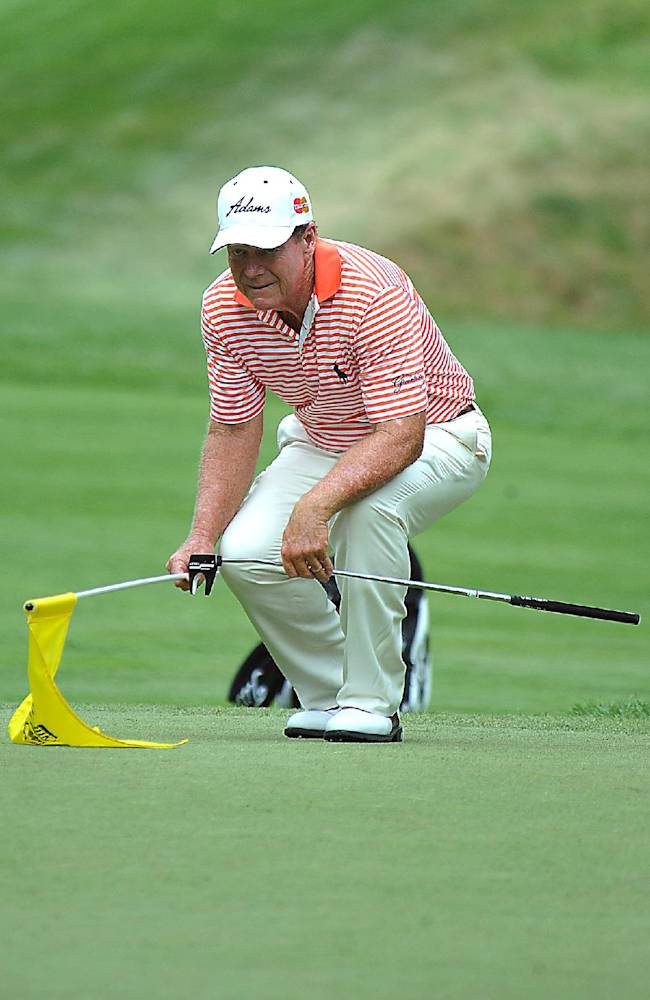 Tom Watson lines up his putt during the first round of the Greenbrier Classic golf tournament at the Greenbrier Resort in White Sulphur Springs, W.Va., Thursday July 3, 2014
