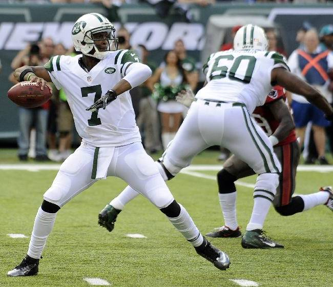 In this Sept. 8, 2013, file photo, New York Jets quarterback Geno Smith (7) throws a pass against the Tampa Bay Buccaneers during the first half of an NFL football game in East Rutherford, N.J. Smith was 10 years old when Tom Brady played his first game against the Jets. On Thursday night, New York's rookie quarterback makes his debut in the rivalry against the New England Patriots' 14-year veteran