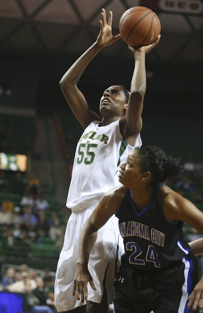 Baylor's Khadijiah Cave (55) shoots past Oklahoma City Autumn Huffman during the first half of an NCAA college basketball exhibition game, Tuesday, Nov. 5, 2013, in Waco, Texas