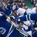 Tampa Bay Lightning's Brett Connolly, back left, and Brian Boyle, back right, and Vancouver Canucks' Zack Kassian, front left, and Brad Richardson get in a scuffle after the whistle during the first period of an NHL hockey game Saturday, Oct. 18, 2014, in