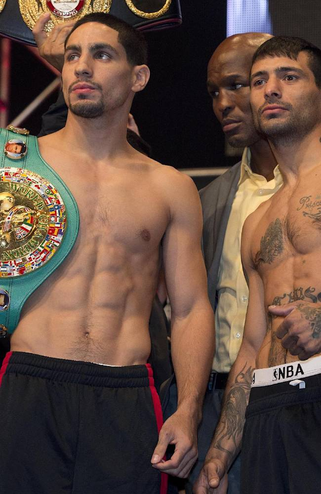 Danny Garcia, left, and Lucas Matthysse pose for photos after the weigh-in for their super lightweight boxing title fight, Friday, Sept. 13, 2013, in Las Vegas. Matthysse will challenge Garcia for the WBC and WBA titles on Saturday