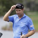 Padraig Harrington, of Ireland, acknowledges the fans on the ninth hole during the second round of the Honda Classic golf tournament, Saturday, Feb. 28, 2015, in Palm Beach Gardens, Fla. (AP Photo/Alan Diaz)