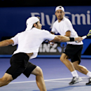 Italy's Simone Bolelli, rear, and Fabio Fognini, left, play a shot to France's Pierre-Hugues Herbert Nicolas Mahut in the men's doubles final at the Australian Open tennis championship in Melbourne, Australia, Saturday, Jan. 31, 2015. (AP Photo/Rob Griffith)