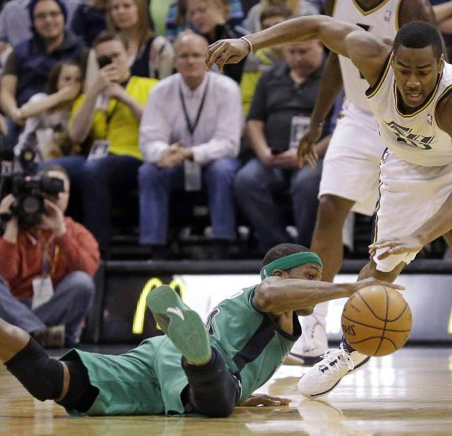 Boston Celtics' Rajon Rondo, left, and Utah Jazz's Alec Burks, right, chase a loose ball in the second half of an NBA basketball game, Monday, Feb. 24, 2014, in Salt Lake City. The Jazz won 110-98