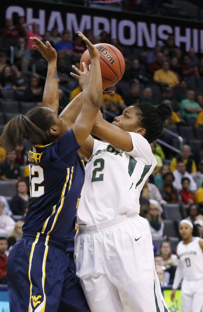 Baylor guard Niya Johnson (2) shoots over West Virginia guard Linda Stepney (22) in the first half of an NCAA college basketball game in the finals of the Big 12 Conference women's college tournament in Oklahoma City, Monday, March 10, 2014. Baylor won 74-71