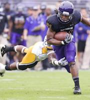 East Carolina's Vintavious Cooper, right, avoids a tackle in the first half by Southern Miss's DeBarriaus Miller during an NCAA college football game at Dowdy-Ficklen Stadium Saturday, Oct. 19, 2013, in Greenville, N.C. (AP Photo/The Daily Reflector, Scott Davis)