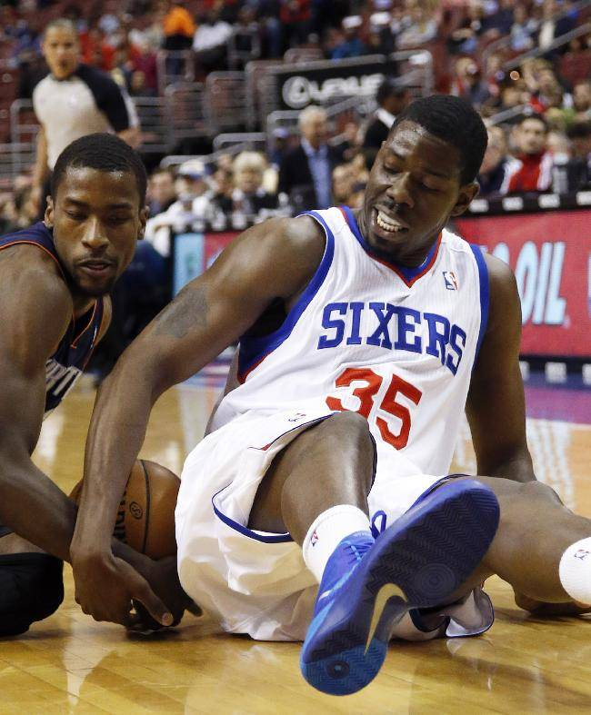 Charlotte Bobcats' Michael Kidd-Gilchrist, left, and Philadelphia 76ers' Henry Sims wrestle for a loose ball during the first half of an NBA basketball game, Wednesday, April 2, 2014, in Philadelphia