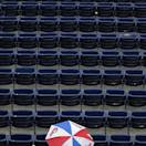 Philadelphia Phillies fans wait out a rain delay before a baseball game against the Washington Nationals, Tuesday, June 18, 2013, in Philadelphia. (AP Photo/Matt Slocum)