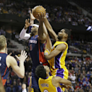 Detroit Pistons forward Josh Smith (6) is charged with an offensive foul on Los Angeles Lakers forward Nick Young (0) during the closing seconds of their NBA basketball game at the Palace in Auburn Hills, Mich., Friday, Nov. 29, 2013 The Associated Press