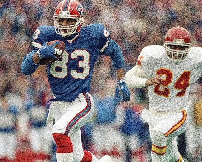 In this Jan. 15, 1992 file photo, Buffalo Bills wide receiver Andre Reed runs with the ball during an AFC playoff football game against the Kansas City Chiefs in Orchard Park, N.Y. Reed was elected to the Pro Football Hall of Fame on Saturday, Feb. 1, 2014
