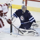 Phoenix Coyotes' Martin Hanzal (11) scores against Winnipeg Jets' goaltender Ondrej Pavelec (31) during third-period NHL hockey game action in Winnipeg, Manitoba, Thursday, Feb. 27, 2014 The Associated Press