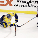 Nashville Predators left wing Taylor Beck (41) and Chicago Blackhawks right wing Kris Versteeg (23) chase after the puck in the second period of an NHL hockey game Thursday, Oct. 23, 2014, in Nashville, Tenn The Associated Press