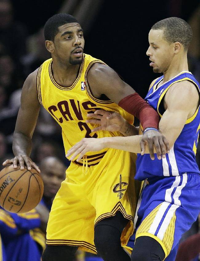 Cleveland Cavaliers' Kyrie Irving, left, tries to get past Golden State Warriors' Stephen Curry during the fourth quarter of an NBA basketball game, Sunday, Dec. 29, 2013, in Cleveland. The Warriors defeated the Cavaliers 108-104 in overtime