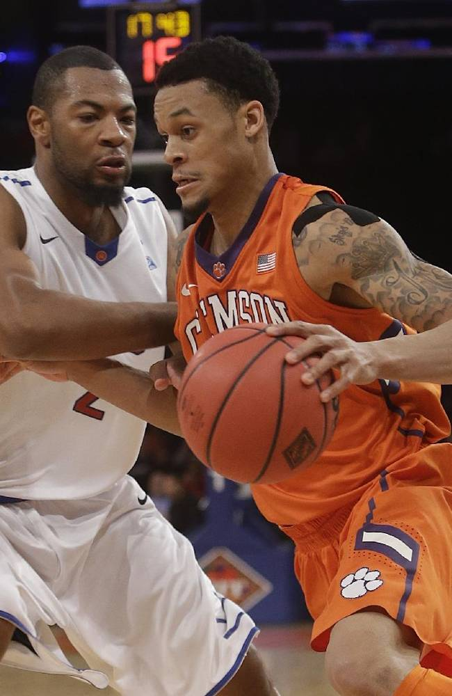 SMU's Shawn Williams (2) defends Clemson's K.J. McDaniels (32) during the second half of an NCAA college basketball game in the semifinals of the NIT Tuesday, April 1, 2014, in New York. SMU won the game 65-59