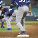 Los Angeles' Justin Turner throws wildly to first during their exhibition baseball game against Team Australia at the Sydney Cricket ground in Sydney, Thursday, March 20, 2014. The Arizona Diamondbacks and Dodgers open the Major League Baseball regular se