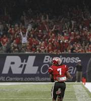 Louisiana-Lafayette cornerback Corey Trim (7) is off to a touchdown with an Tulane interception during the first half of the New Orleans Bowl NCAA college football game, Saturday, Dec. 21, 2013, in New Orleans. (AP Photo/Bill Haber)