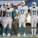 Miami Dolphins running back Lamar Miller (26), quarterback Ryan Tannehill (17), and wide receiver Mike Wallace (11) watch from the sideline during the second half of an NFL football game against the Kansas City Chiefs, Sunday, Sept. 21, 2014, in Miami Gar