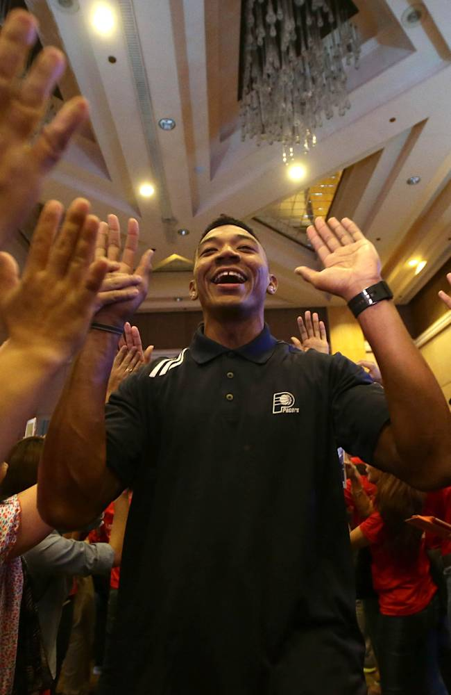 The Indiana Pacers Orlando Johnson exchanges high-fives with Filipino fans as he arrives for an audience with a Non-Government Organization fighting for the eradication of Diabetes and its complications Monday Oct. 7, 2013 in Manila, Philippines. The Houston Rockets and the Indiana Pacers flew in Monday for the first NBA game in this basketball-crazy Southeast Asian nation Thursday evening. The game is part of the NBA's global schedule that will have eight teams play in six countries this month