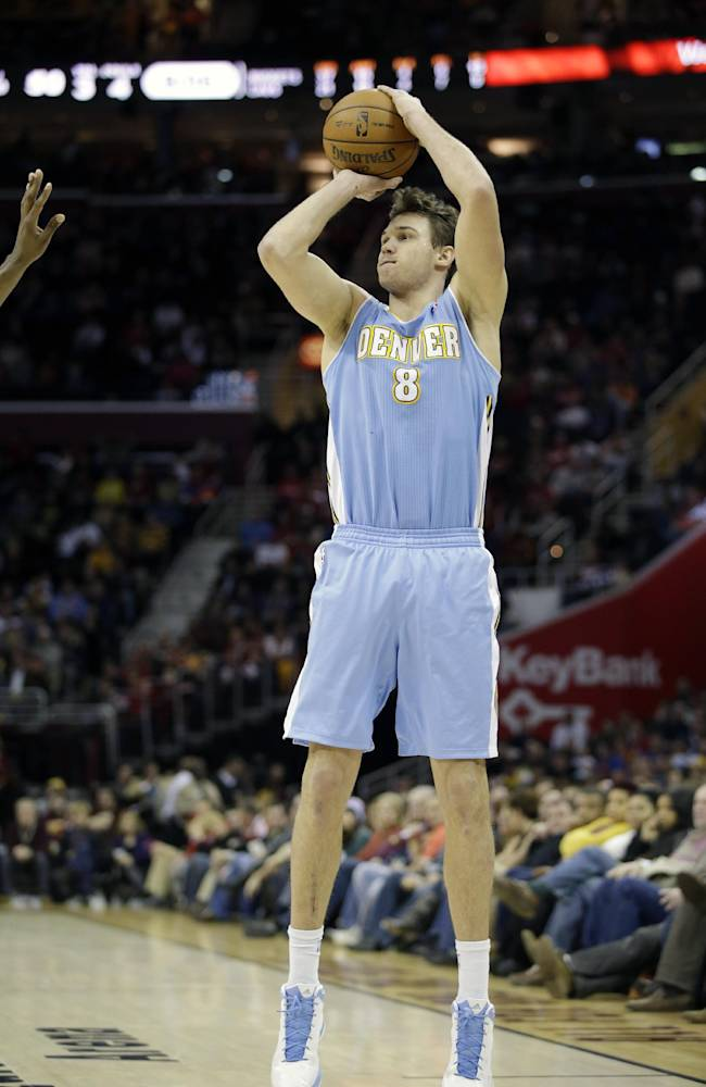 In this Feb. 9, 2013 file photo, Denver Nuggets' Danilo Gallinari shoots against the Cleveland Cavaliers in an NBA basketball game in Cleveland. The Nuggets sure could use the long-range shooting of Gallinari. The Italian forward is sidelined until at least December, recovering from a torn knee ligament