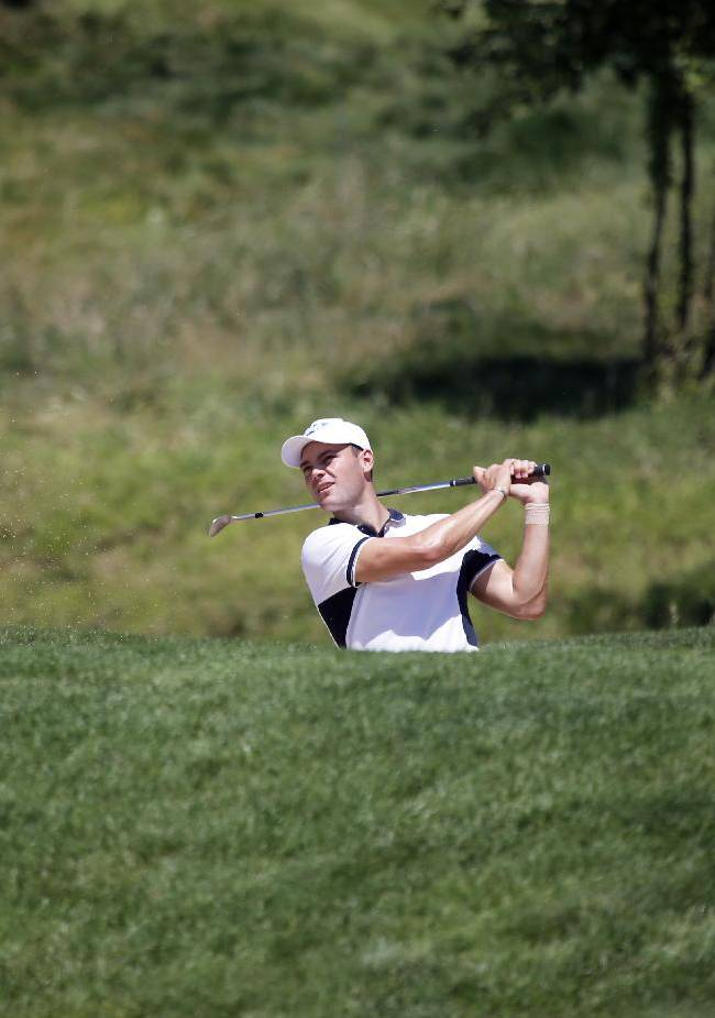 Martin Kaymer of Germany tees off during the first day of the French Open Golf tournament at Paris National course in Guyancourt, west of Paris, France, Thursday, July 3, 2014