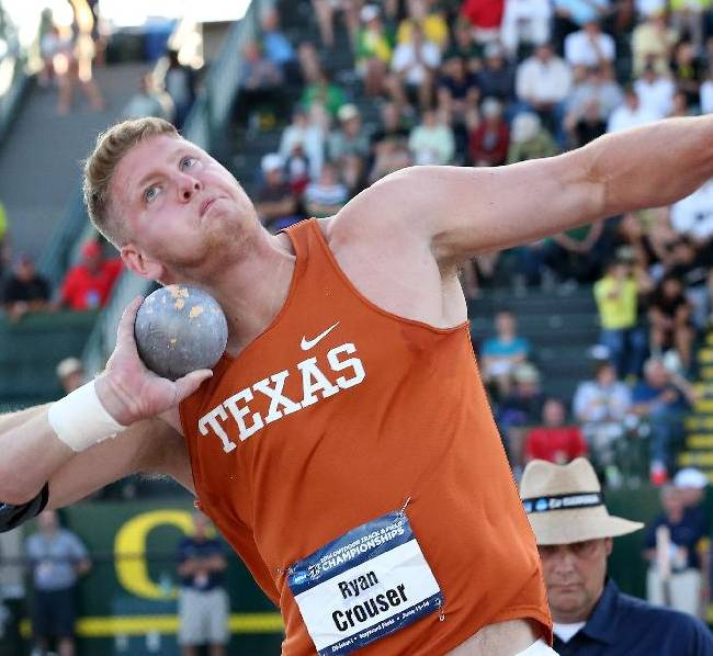 Texas' Ryan Crouser throws during the shot put at the NCAA outdoor track and field championships Wednesday, June 11, 2014, in Eugene, Ore. Crouser won the event at 69-3 1/2 for his third straight title in the event