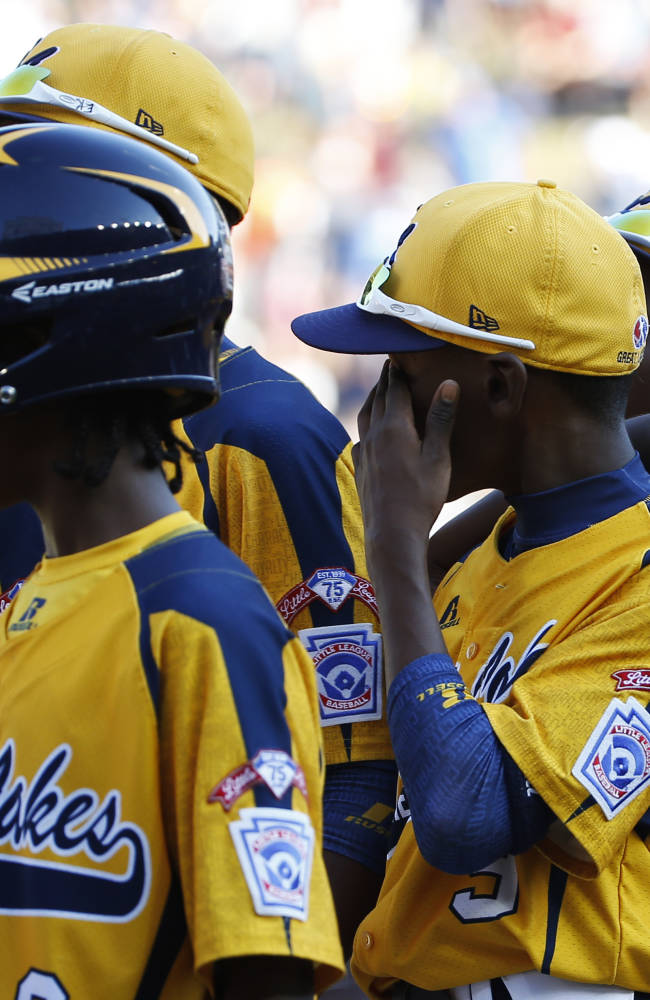 Chicago players watch as South Korea players celebrate after winning the championship baseball game at the Little League World Series, Sunday, Aug. 24, 2014, in South Williamsport, Pa. South Korea won 8-4. (AP Photo/Matt Slocum)