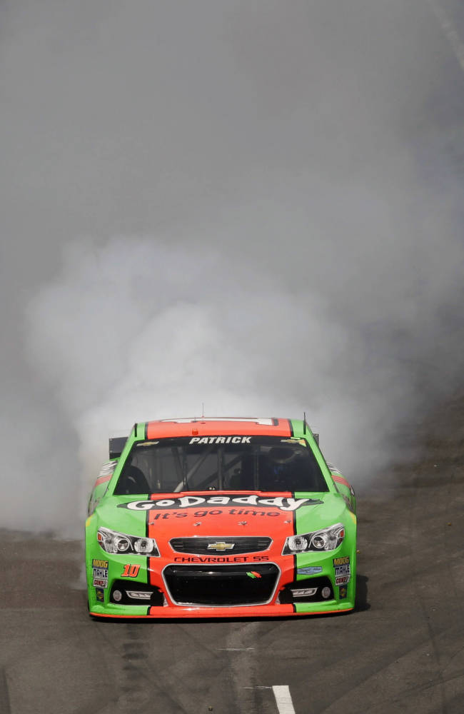 Danica Patrick has a mechanical failure while leaving a pit stop during the Brickyard 400 auto race at Indianapolis Motor Speedway in Indianapolis, Sunday, July 27, 2014
