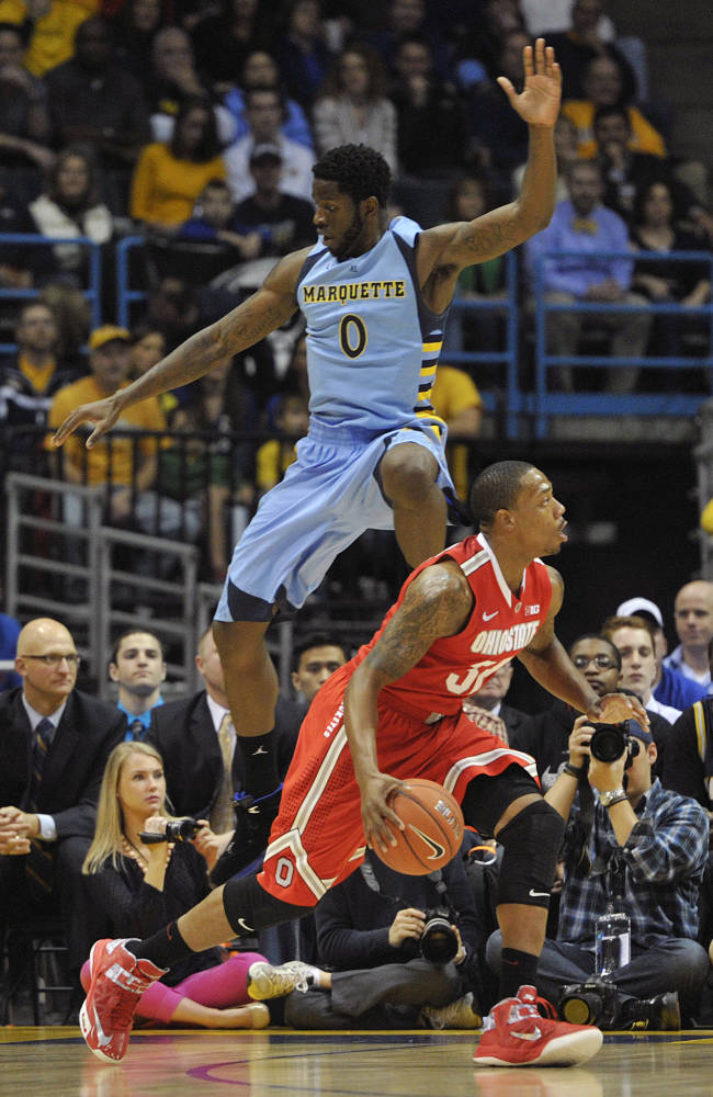 No. 10 Ohio State beats No. 17 Marquette 52-35