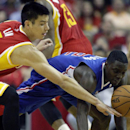Houston Rockets guard Jeremy Lin, left, and Los Angeles Clippers guard Darren Collison dive for a loose ball during the second quarter of an NBA basketball game, Saturday, March 29, 2013, in Houston The Associated Press