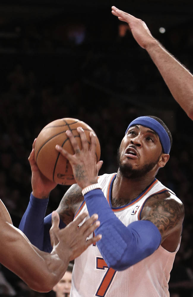 James, Heat snap Knicks' streak at 4, 106-91